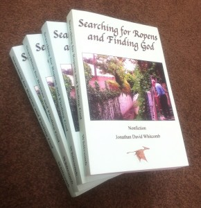 "pile of nonfiction books: ""Searching for Ropens and Finding God"" - by Jonathan Whitcomb"